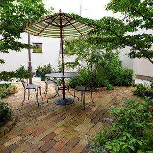 他の地域のトラディショナルスタイルのおしゃれな庭の写真
