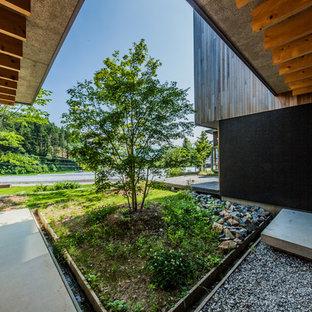 他の地域の中サイズのアジアンスタイルのおしゃれな中庭 (半日向) の写真
