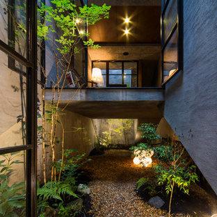 他の地域のアジアンスタイルのおしゃれな庭 (日陰、砂利舗装) の写真