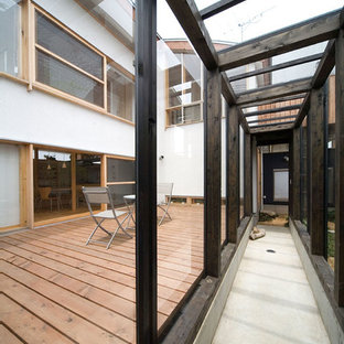 東京23区のコンテンポラリースタイルのおしゃれな廊下 (コンクリートの床、グレーの床) の写真