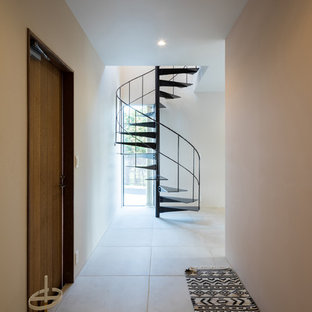 Inspiration for a contemporary concrete floor and gray floor hallway remodel in Other with white walls