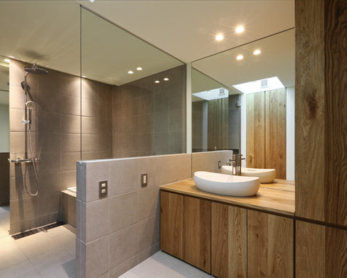 Inspiration For A Contemporary Master Bathroom In Sapporo With Flat Panel  Cabinets, Medium Wood