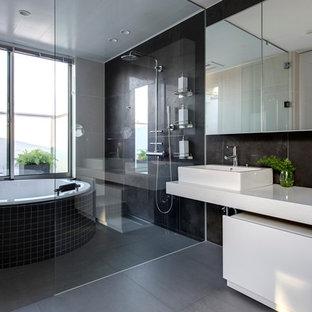Example Of A Mid Sized Trendy Master Black Tile Slate Floor Bathroom Design  In Yokohama