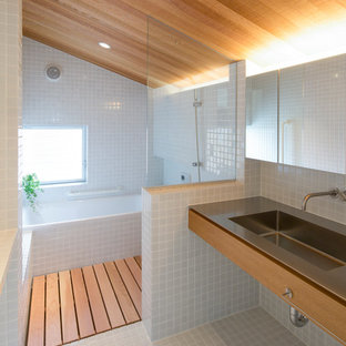 Design ideas for a small asian master bathroom in Nagoya with open cabinets, grey cabinets, an undermount tub, a curbless shower, white tile, mosaic tile, white walls, mosaic tile floors, an undermount sink, stainless steel benchtops, white floor, a shower curtain, grey benchtops, a single vanity, a freestanding vanity and wood.