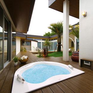 ビーチスタイルのおしゃれな浴室の写真