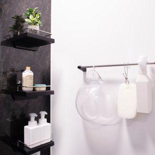Idéer för ett litet modernt vit en-suite badrum, med möbel-liknande, bruna skåp, ett undermonterat badkar, våtrum, svart kakel, plywoodgolv, vitt golv och dusch med gångjärnsdörr