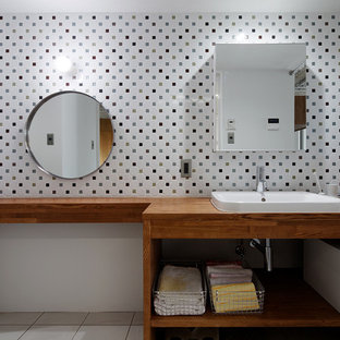 This is an example of a contemporary bathroom in Other with open cabinets, medium wood cabinets, white tiles, white walls, a built-in sink, wooden worktops and brown worktops.