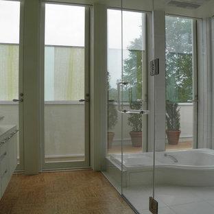 Ispirazione per una stanza da bagno moderna con pavimento in sughero, lavabo a bacinella e top in superficie solida