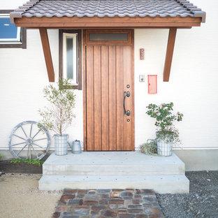 他の地域の片開きドアアジアンスタイルのおしゃれな玄関ドア (木目調のドア) の写真