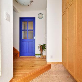 他の地域のコンテンポラリースタイルのおしゃれな玄関の写真
