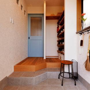 東京23区のミッドセンチュリースタイルのおしゃれな玄関の写真