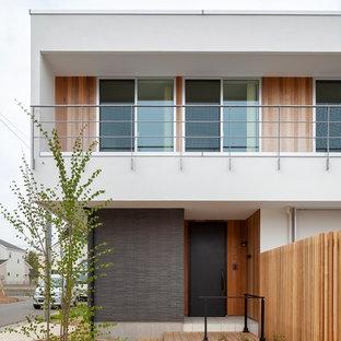 他の地域の片開きドアコンテンポラリースタイルのおしゃれな玄関 (白い壁、黒いドア) の写真