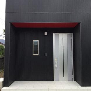 Inspiration pour une entrée minimaliste avec un mur noir, un sol en carrelage de porcelaine, une porte simple, une porte métallisée et un sol violet.