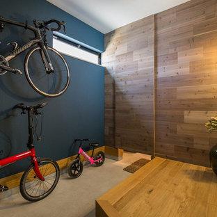 名古屋のラスティックスタイルのおしゃれな玄関 (マルチカラーの壁、コンクリートの床、グレーの床) の写真