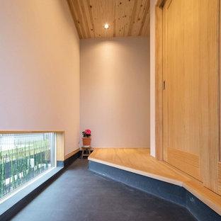 東京23区のアジアンスタイルのおしゃれな玄関の写真