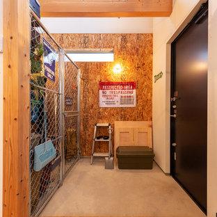 他の地域のインダストリアルスタイルのおしゃれな玄関の写真
