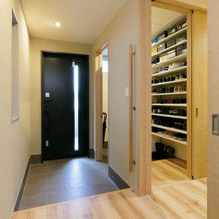 На фото: прихожая со шкафом для обуви в современном стиле с