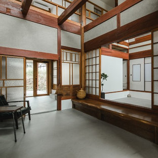 Example Of A Huge Asian Concrete Floor And Gray Floor Entryway Design In  Other With Gray