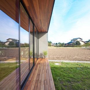 Foto di un portico etnico nel cortile laterale con un tetto a sbalzo