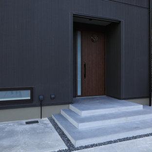 Idee per un portico minimalista di medie dimensioni e davanti casa con pavimentazioni in cemento