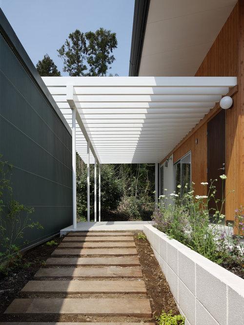 modelo de terraza vintage en patio delantero con huerto adoquines de hormign y