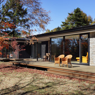 This is an example of a contemporary porch design in Other with decking.