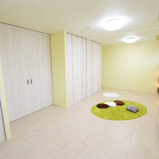 Nursery - scandinavian gender-neutral plywood floor and white floor nursery idea in Other with yellow walls