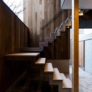 他の地域のコンクリートのアジアンスタイルのおしゃれな折り返し階段の写真