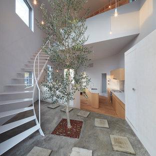 他の地域のコンテンポラリースタイルのおしゃれな階段 (金属の手すり) の写真
