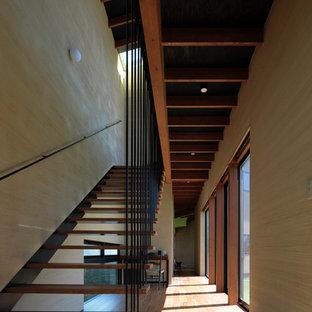 他の地域の木のモダンスタイルのおしゃれな階段の写真