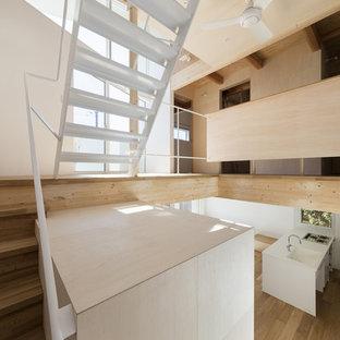 Foto de escalera en L, romántica, con escalones de madera, contrahuellas de madera y barandilla de metal