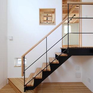 解放感のある吹き抜けが魅力。ダイニング、キッチン、リビングが一体となったデザインハウス