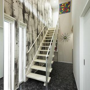 他の地域のコンテンポラリースタイルのおしゃれなオープン階段の写真
