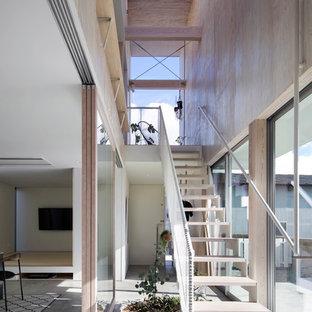 他の地域の木のインダストリアルスタイルのおしゃれな階段の写真