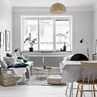 Idéer för att renovera ett mellanstort nordiskt allrum, med grå väggar och målat trägolv