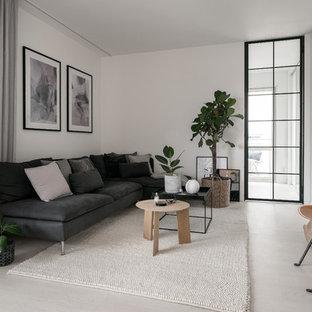 Idéer för mellanstora nordiska avskilda allrum, med vita väggar, betonggolv, en väggmonterad TV och vitt golv