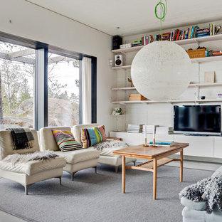 Idéer för att renovera ett mellanstort minimalistiskt avskilt allrum, med vita väggar, betonggolv, en fristående TV och grått golv