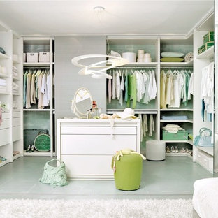 Large trendy women's green floor walk-in closet photo in Cologne with open cabinets