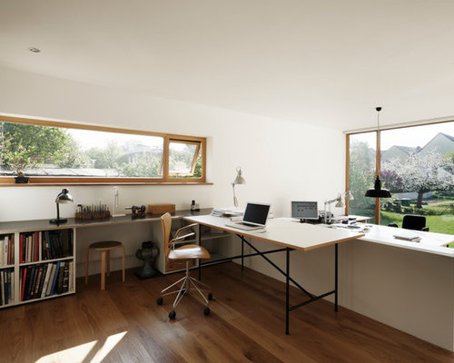 inspiration for a large modern built in desk medium tone wood floor study room remodel - Modern Study Room Interior Design