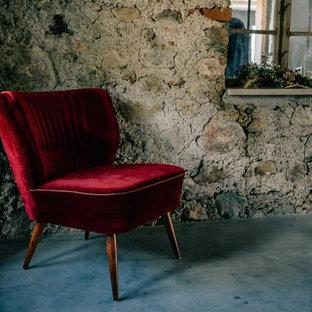 ミュンヘンのインダストリアルスタイルのおしゃれなホームオフィス・書斎 (コンクリートの床) の写真