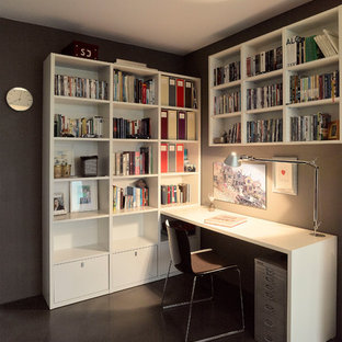 Study room - mid-sized contemporary built-in desk linoleum floor and black floor study room idea in Stuttgart with brown walls and no fireplace