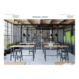 Пример оригинального дизайна: маленькое рабочее место в стиле лофт с белыми стенами, бетонным полом, отдельно стоящим рабочим столом, синим полом, сводчатым потолком и кирпичными стенами