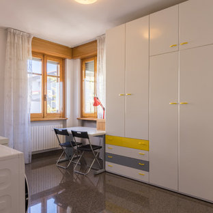 Design ideas for a mid-sized modern gender-neutral built-in wardrobe in Other with flat-panel cabinets, marble floors, black floor and white cabinets.