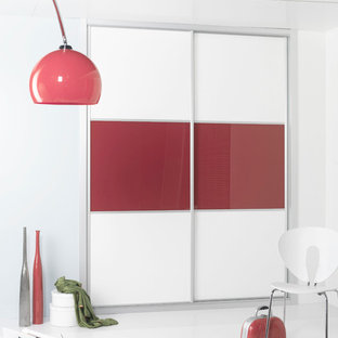 Small contemporary gender-neutral built-in wardrobe in Other with flat-panel cabinets and red cabinets.