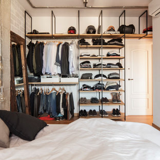 Large industrial storage and wardrobe in Barcelona with medium hardwood floors.