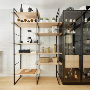 Inspiration for a large industrial storage and wardrobe in Other.