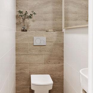 Esempio di un piccolo bagno di servizio nordico con ante bianche, WC sospeso, piastrelle bianche, piastrelle in ceramica, pareti bianche, pavimento in gres porcellanato, lavabo sospeso, pavimento marrone e mobile bagno sospeso