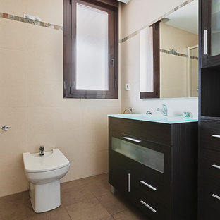 Photo of a small contemporary cloakroom in Other with freestanding cabinets, brown cabinets, a bidet, multi-coloured tiles, ceramic tiles, beige walls, ceramic flooring, a vessel sink and brown floors.