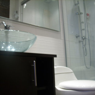 This is an example of a small modern cloakroom in Other with a one-piece toilet, white tiles, ceramic tiles, white walls, slate flooring, a vessel sink and multi-coloured floors.