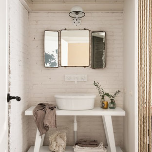 Small traditional powder room in Other with open cabinets, white cabinets, a vessel sink, white walls, concrete floors and grey floor.